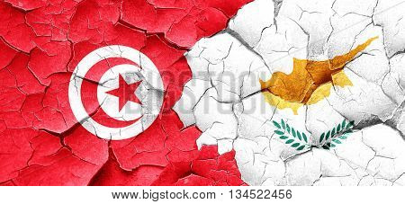 Tunesia flag with Cyprus flag on a grunge cracked wall