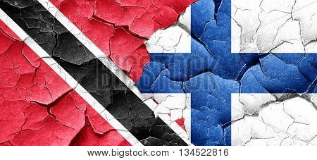 Trinidad and tobago flag with Finland flag on a grunge cracked w