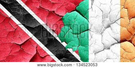 Trinidad and tobago flag with Ireland flag on a grunge cracked w