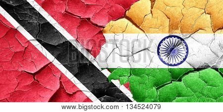 Trinidad and tobago flag with India flag on a grunge cracked wal