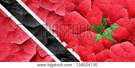 Trinidad and tobago flag with Morocco flag on a grunge cracked w
