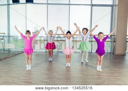 happy children dancing on in hall, healthy life, kid's togetherness and happiness concept.