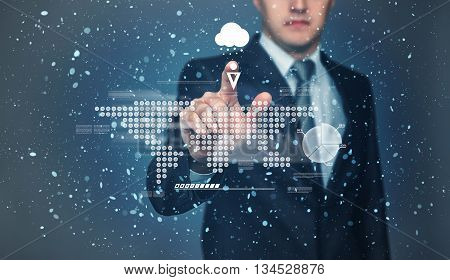 Businessman touching touch screen with projection of graphic world map representation by his finger. Weather forecast. Chance of precipitation as snow. Innovative technology. Digital presentation.