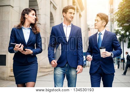 Group of business people walking on street