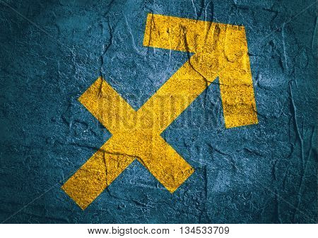 Archer astrology sign. Yellow astrological symbol on concrete textured backdrop