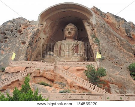 The buddhist cave complex Xumishan includes a giant 21 m statue of Buddha Maitreya and a few dozens of cave temples. It is located in the remote areas about 55 km north-west from the city of Guyuan, located in Ningxia Hui Autonomous Region in China.