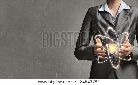 Atom molecule in hands