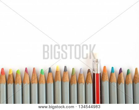 Colorful pencil and rubber arrange on the wooden table symbolized to be a forgiveness,resolving isolated on white background with copy space