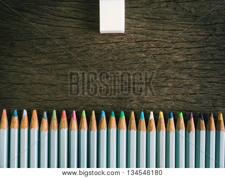 Colorful Pencil And Rubber Arrange On The Wooden Table Symbolized To Be A Forgiveness,resolving With