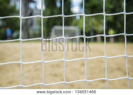 Beach soccer football goal through the net. Rio games.