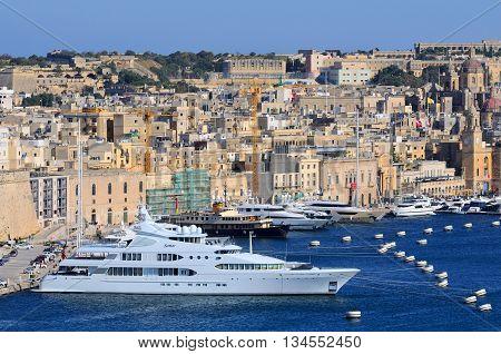 VALLETTA MALTA - APR 17 :Valletta Port in Malta April 17 2011. The Valletta port is a popular tourist attraction full of cafes and restaurants.