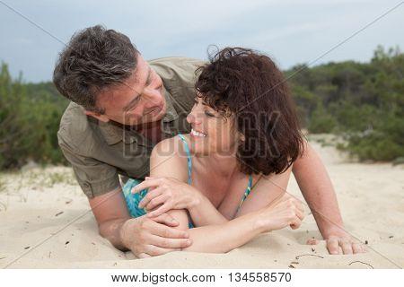 Middle-aged Couple Happy At The Beach On The Sand