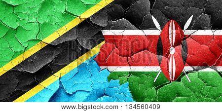 Tanzanian flag with Kenya flag on a grunge cracked wall