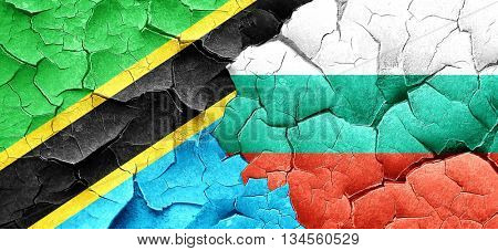 Tanzanian flag with Bulgaria flag on a grunge cracked wall