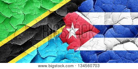 Tanzanian flag with cuba flag on a grunge cracked wall