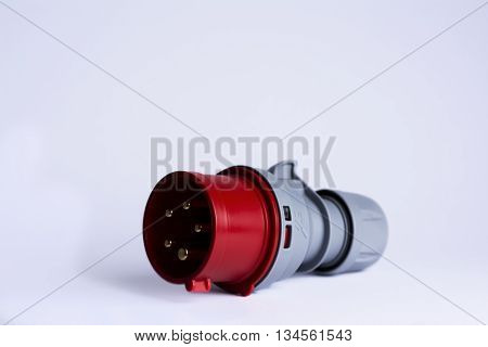 a red and grey cee plug isolated