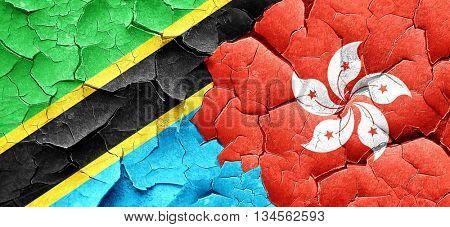 Tanzanian flag with Hong Kong flag on a grunge cracked wall