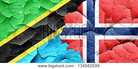 Tanzanian flag with Norway flag on a grunge cracked wall