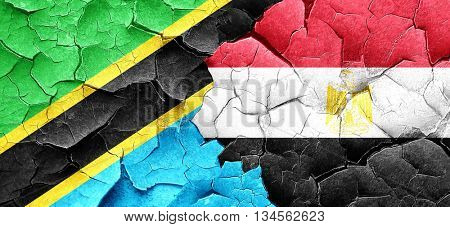 Tanzanian flag with egypt flag on a grunge cracked wall
