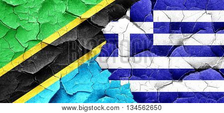 Tanzanian flag with Greece flag on a grunge cracked wall