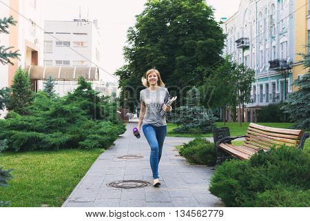 Student Walking In Park