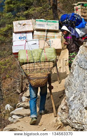 Porters Carry Heavy Load In Himalaya, Nepal