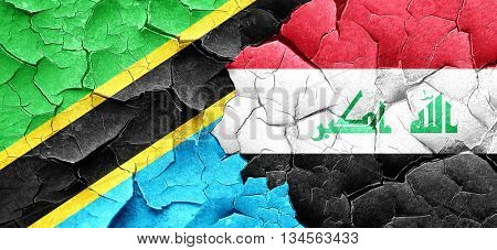 Tanzanian flag with Iraq flag on a grunge cracked wall