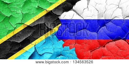 Tanzanian flag with Russia flag on a grunge cracked wall