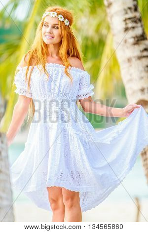 young beautful woman on tropical tree background, summer vacation on paradise island