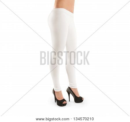 Woman wears white blank leggings mockup, isolated, clipping path. Slim legs in apparel.