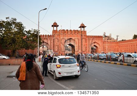 Jaipur India - December 29 2014: People at the main gate to Indra Bazar in Jaipur Rajasthan in India as seen on December 29 2014. Jaipur known as the Pink City is a major tourist destination in India.