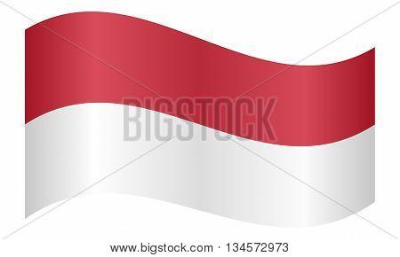 Flag of Monaco waving on white background