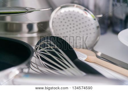 the Various tableware on shelf in the kitchen