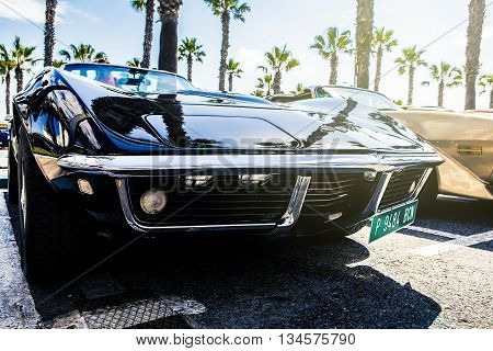 Benalmadena, Spain - June 21, 2015: A black Chevrolet Corvette C3, front view, parked in the port of Benalmadena (Spain), on June 21, 2015.