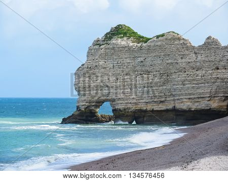 Cote d'Albatre or Alabaster Coast is part of the French coast of the English Channel. Famous cliff La Falaise d'Amont. Etretat France