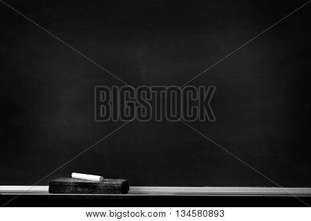 Chalkboard with chalk eraser marks in white chalk