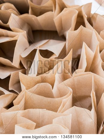 the Brown paper disposable bags in the pile