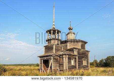 Ancient deserted wooden orthodox church in the village Verkhovie Arkhangelsk region Russia