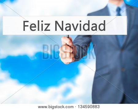 Feliz Navidad (merry Christmas In Spanish) - Businessman Hand Holding Sign