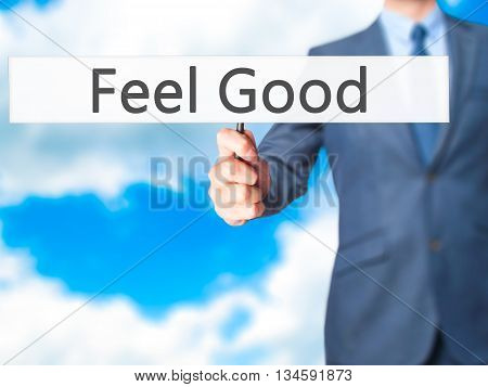 Feel Good - Businessman Hand Holding Sign