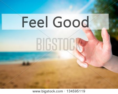 Feel Good - Hand Pressing A Button On Blurred Background Concept On Visual Screen.