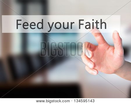 Feed Your Faith - Hand Pressing A Button On Blurred Background Concept On Visual Screen.