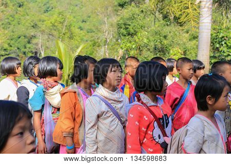 Tak Thailand-Jan 15: Karen children back home after class from border primary scool on Jan 15 2015 in Tha Song Yang Tak Thailand. School located in mountain near Thailand-Myanmar border for help and teach Ethnics children