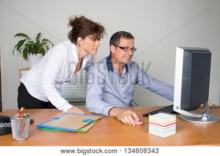 Business colleagues working at desk in a warehouse