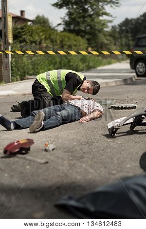 Paramedic Resuscitating Traffic Collision Victim