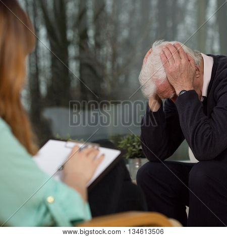 Senior with neurosis at the psychotherapy session