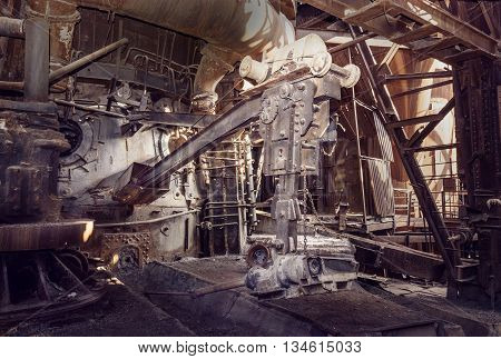 Old devices for opening the iron taphole in blast furnace workshop on Mining and metallurgical plant poster