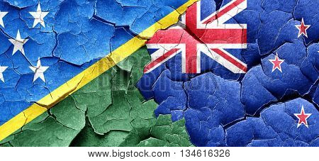 Solomon islands flag with New Zealand flag on a grunge cracked w