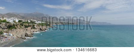 Panoramic view on the coast of Nerja as seen from balcon de Europa. Costa del Sol. Malaga Andalusia Spain