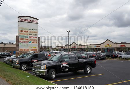 JOLIET, ILLINOIS / UNITED STATES - OCTOBER 9, 2015: The Crossroads Plaza is one of the busiest strip malls in West Joliet.